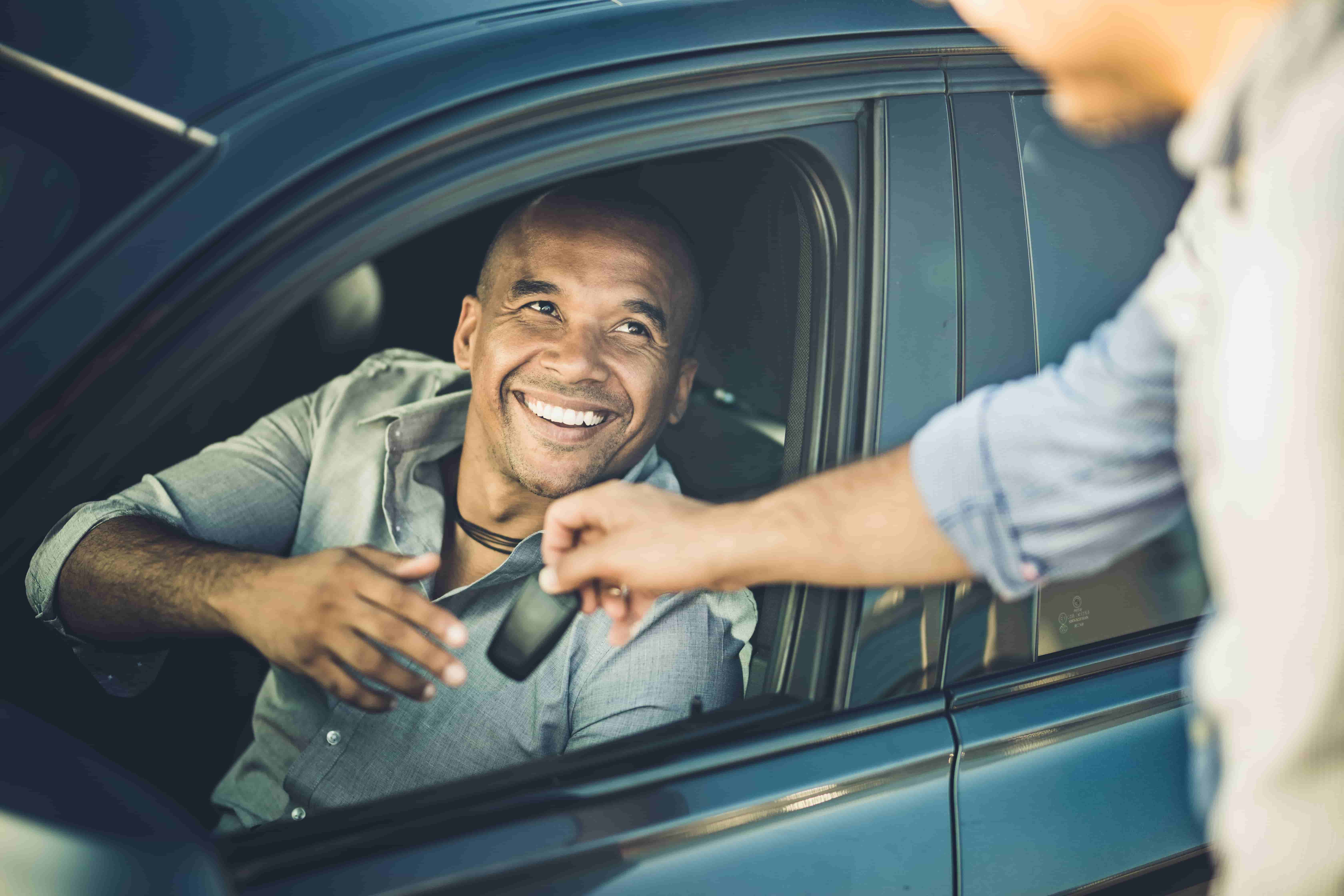 man with a credit card that is good for car rental insurance