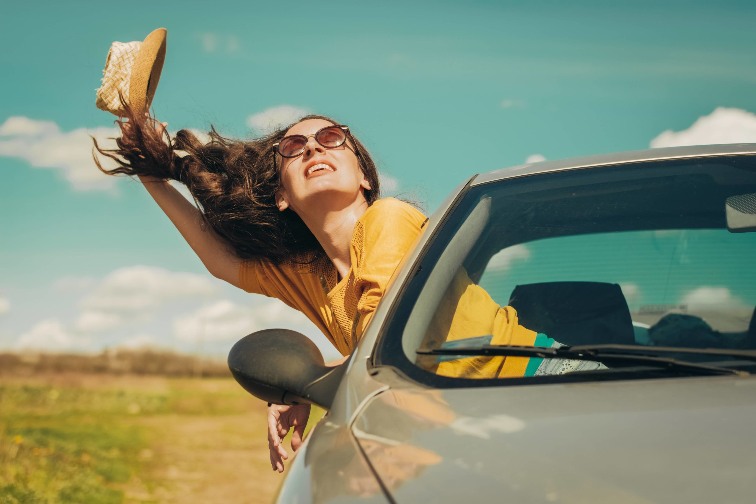 woman excited to use a credit card for car rental insurance