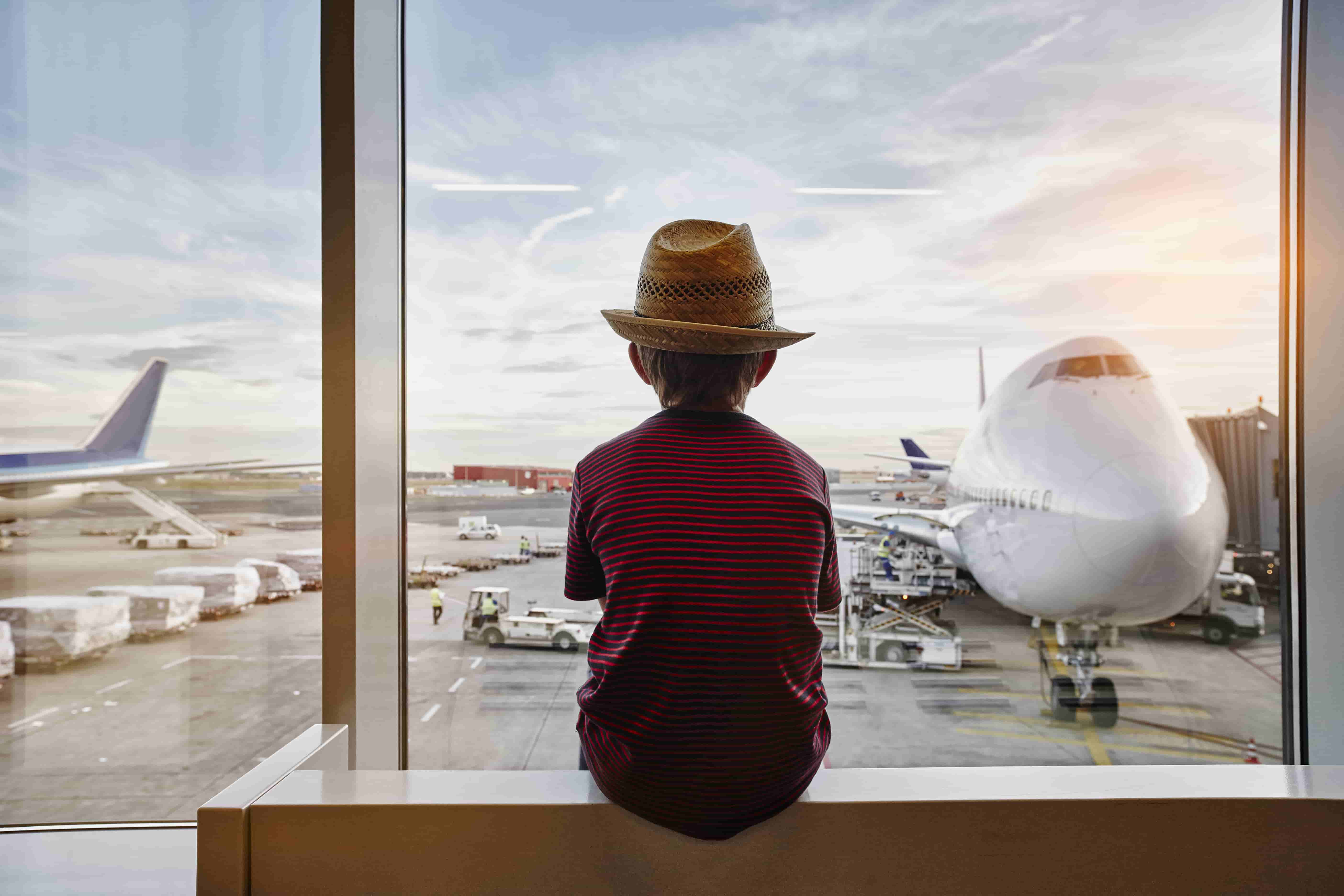 child watching airplanes