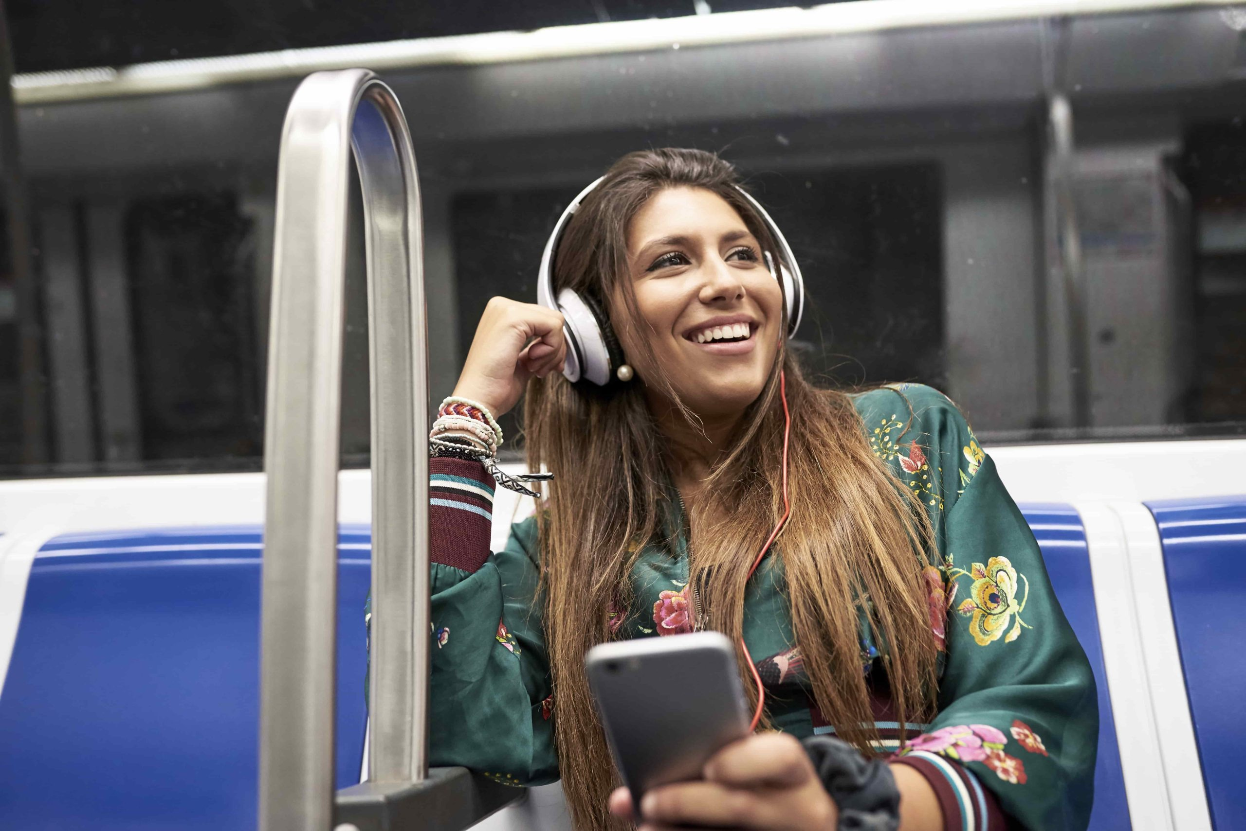 Woman listening to music that has the best balance transfer credit card