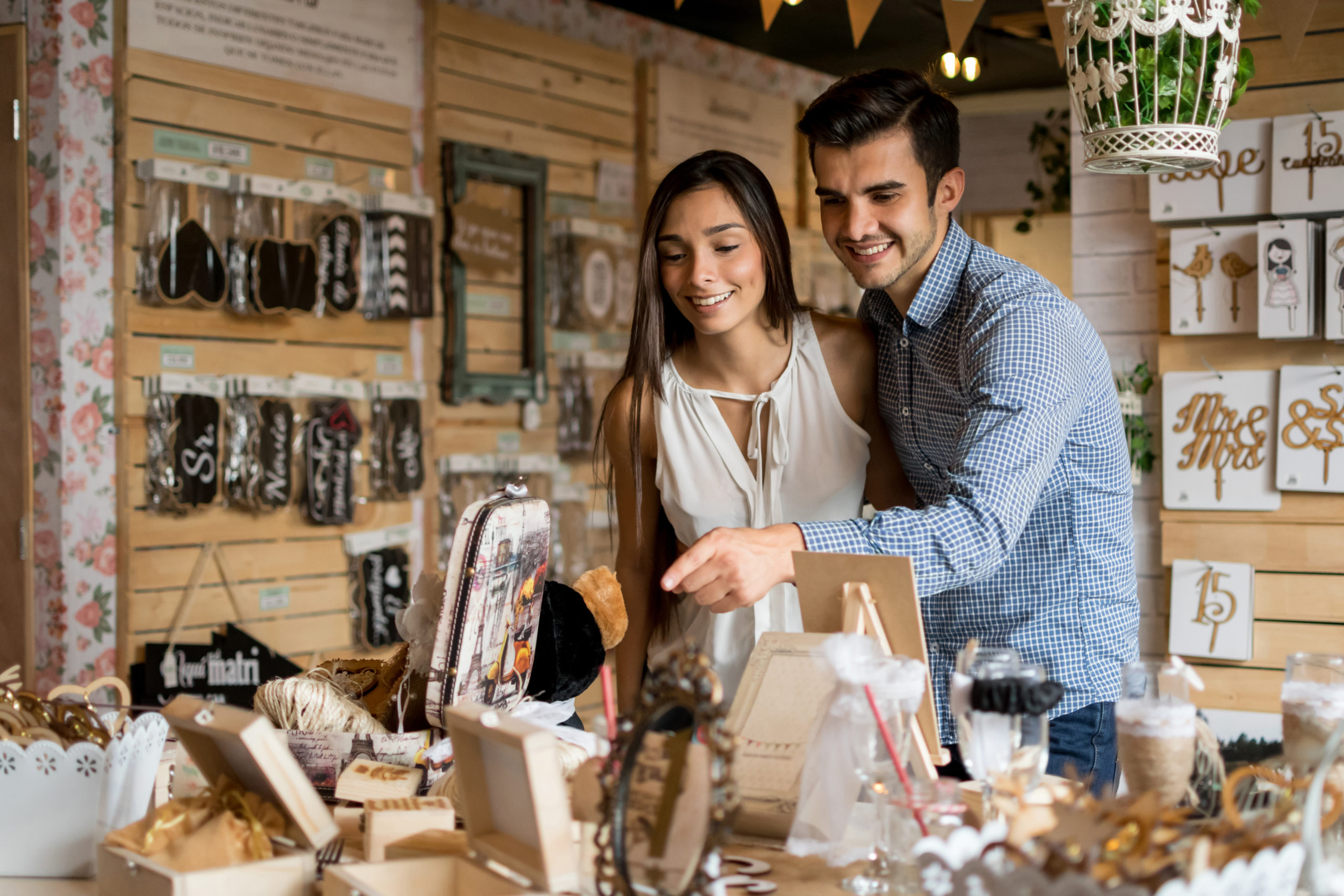 Young couple looking for wedding favors at a small business