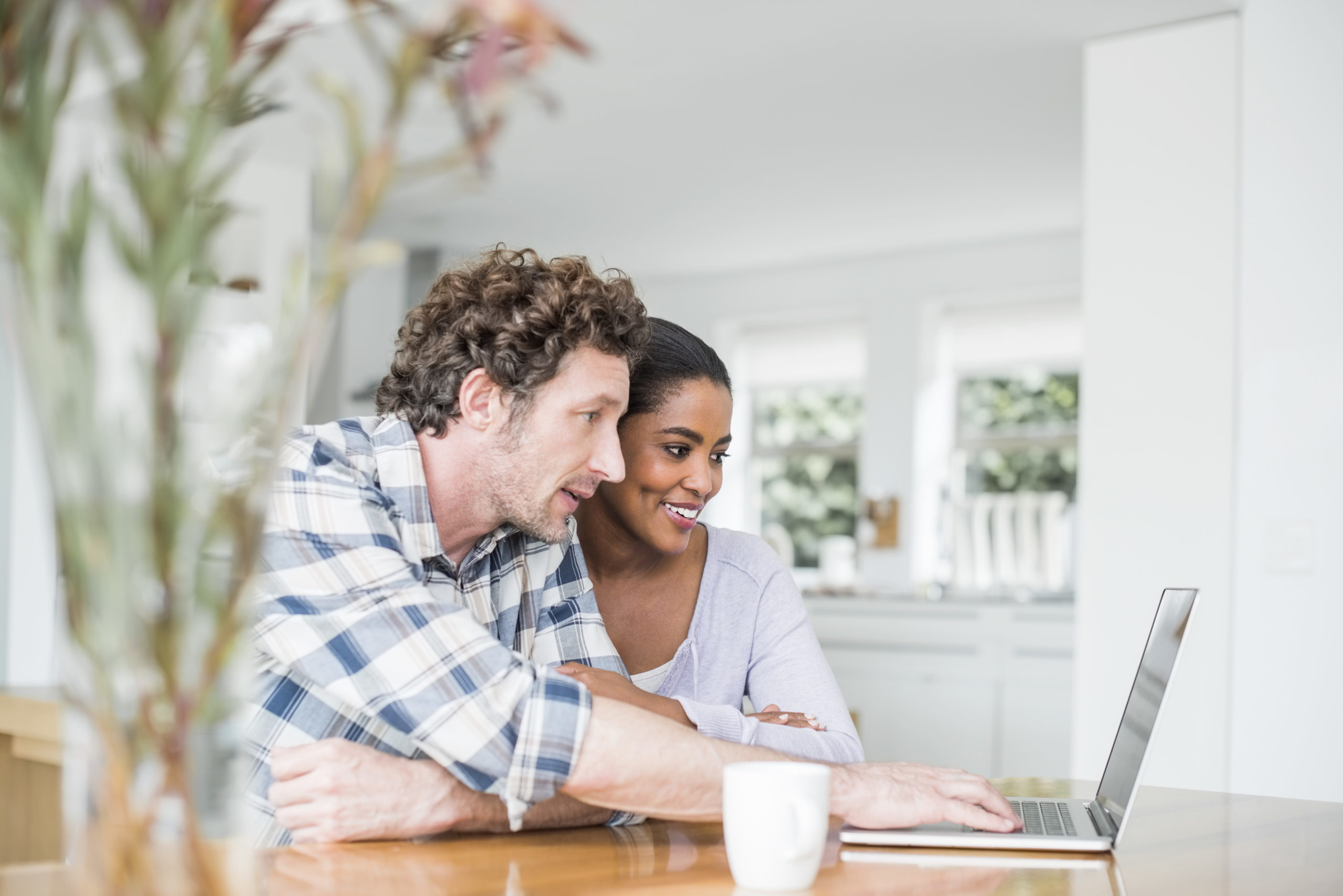 Couple looking at mortgage offers