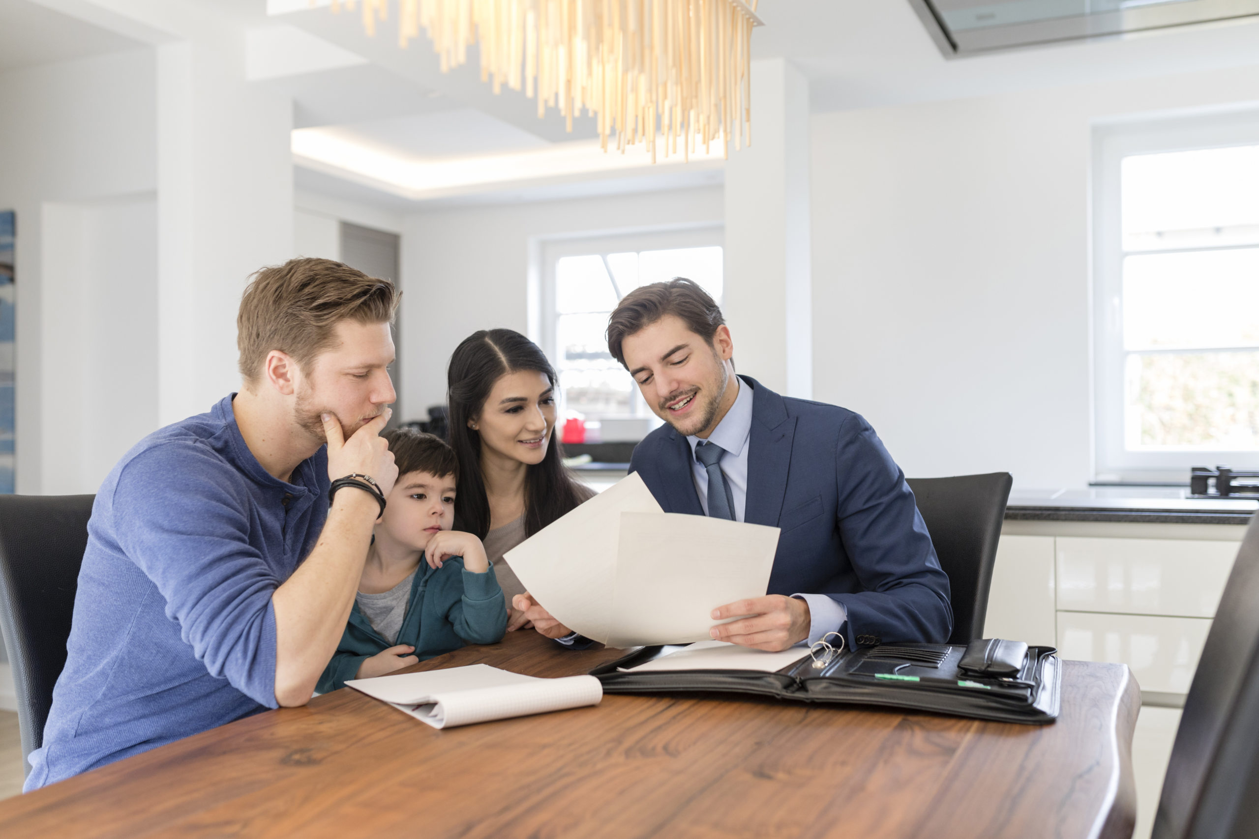 Couple looking into PMI insurance