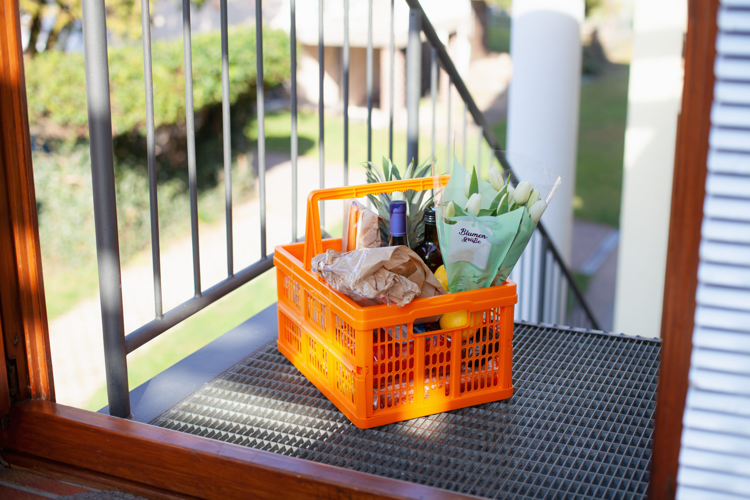Neighborly help: A basket full of groceries left at the door