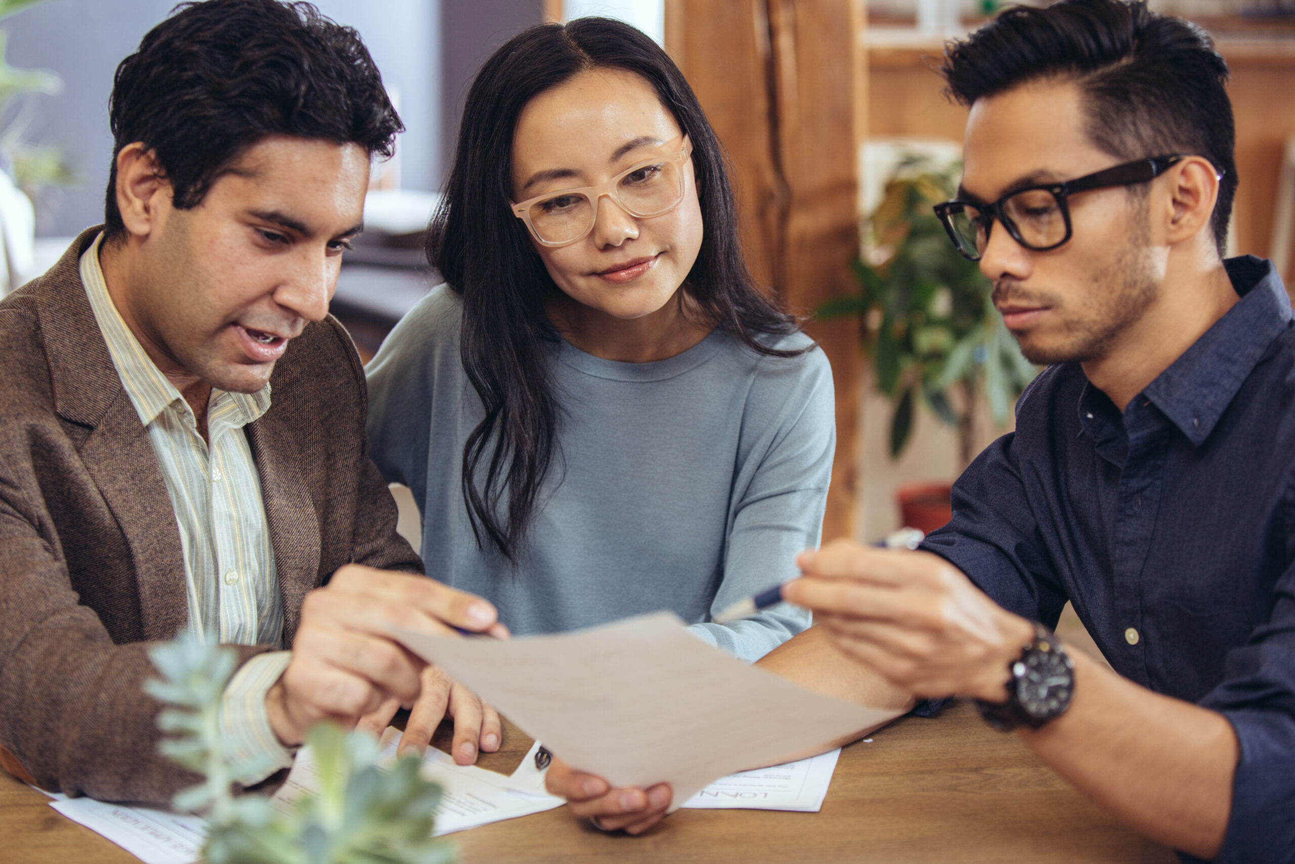 a couple receiving mortgage preapproval advice from an advisor