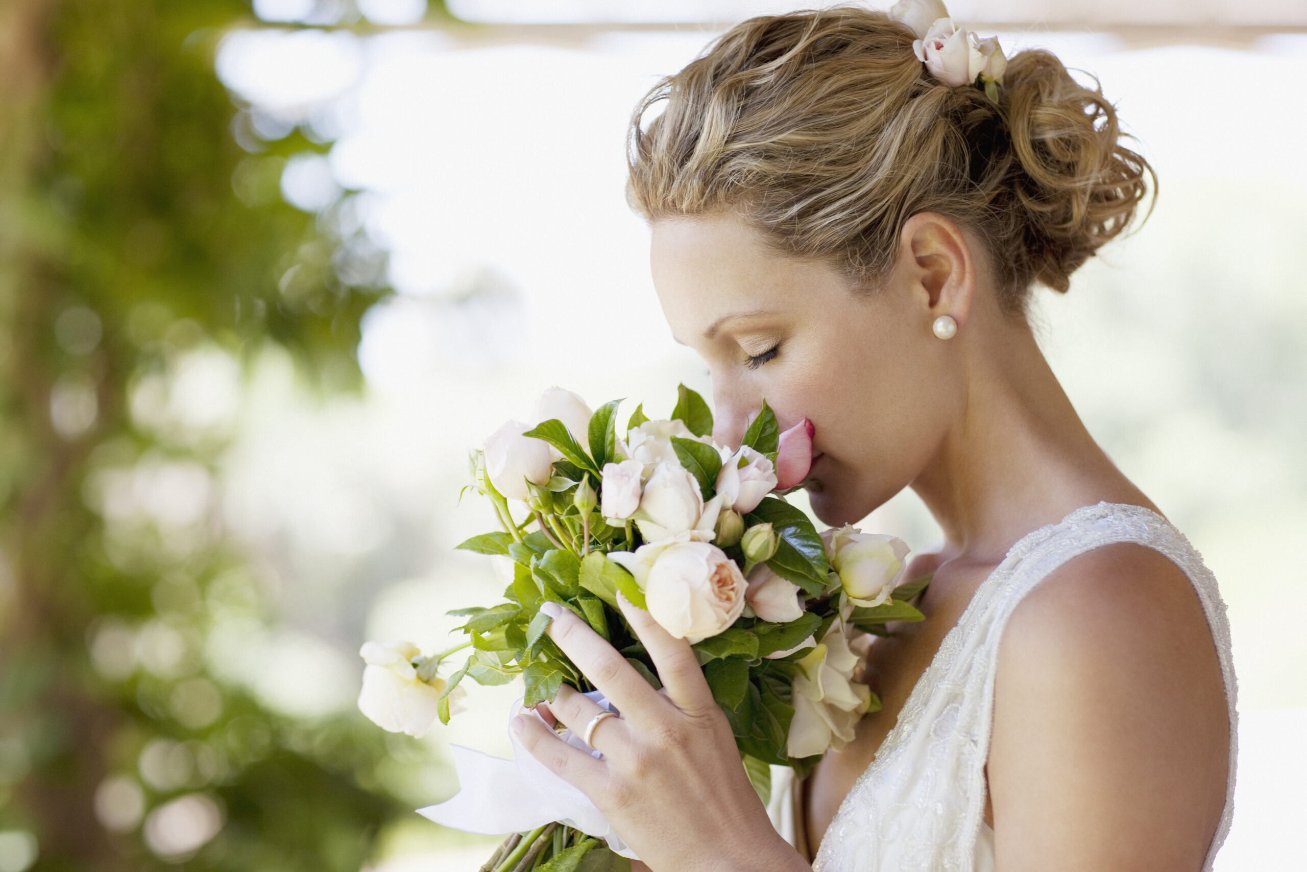 a bride holding wedding flowers