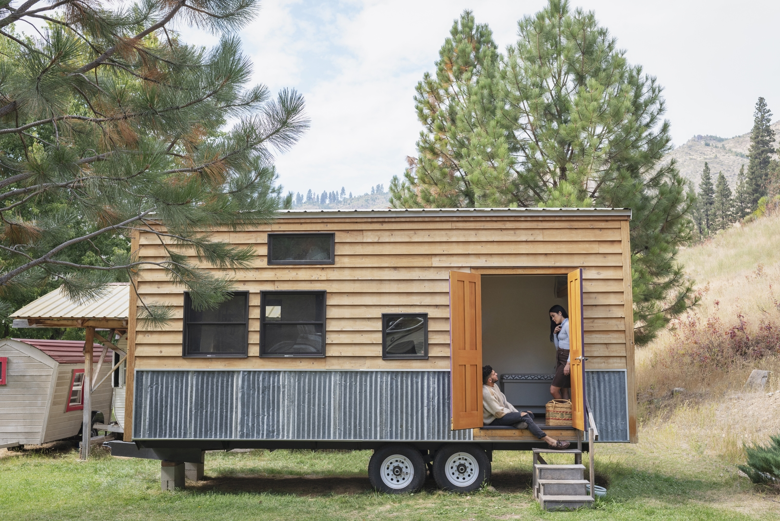 couple discussing tiny house pros and cons before buying a tiny home